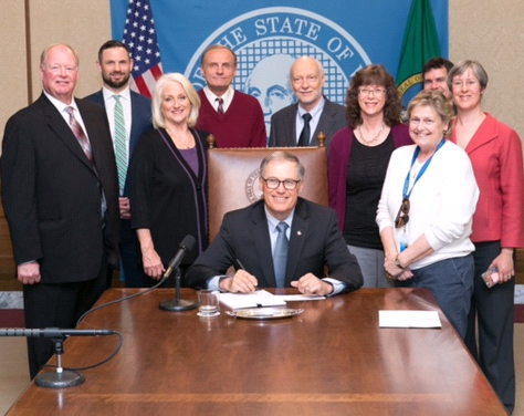 The Governor signing the bill.